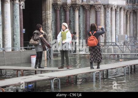 Acqua alta at Saint Mark's square, Venice, Italy - Stock Image