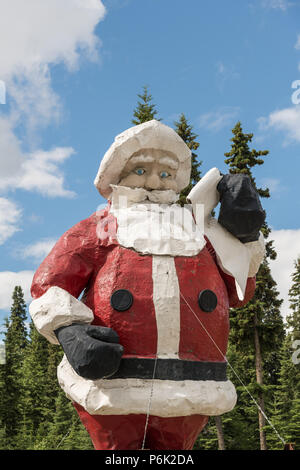 The worlds largest Santa Claus statue at the Santa Claus House in North Pole, Alaska. The 42-foot statue weighs 900 pounds and was originally built in the 1960s and originally served as a seasonal display at the Westlake Mall in Seattle before being relocated to North Pole. - Stock Image