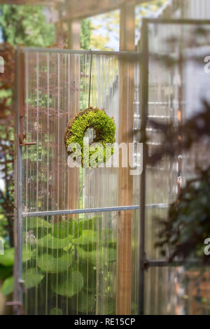 Doorway leading into a greenhouse - Stock Image