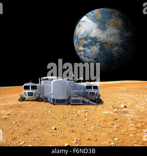 An artist's depiction of a lunar base on a barren moon. The moon's Earth-like planet rises in the background. - Stock Image