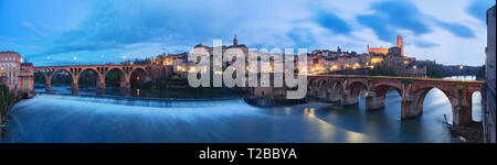Albi, France. Panoramic cityscape at dusk made from bank of Tarn river - Stock Image