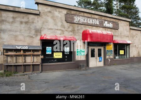 A building from a failed business up for auction due to tax foreclosure in Speculator, NY USA - Stock Image
