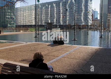 France, Paris, La Defense, Esplanade de La Defense, bu the Bassin de Takis during lunchtime, February 2016. - Stock Image