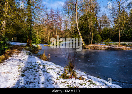 Upper Lake in the snow at Stowe, Buckinghamshire, UK - Stock Image