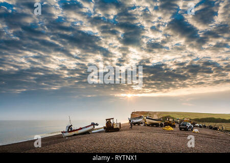Fishermen on Salthouse beach in Norfolk prepare to launch just after dawn. - Stock Image