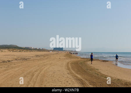 Morning exercise on beach walk Costa Blanca between Torre la Mata and Guardamar del Segura Spain - Stock Image