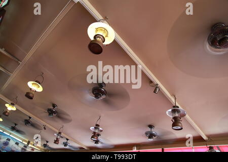 roof fans in Hawker stall chinatown Singapore - Stock Image