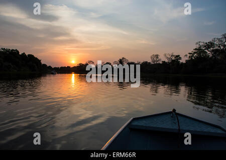 Sunset as seen from a boat on the Cuiaba River, Pantanal, Mato Grosso, Brazil - Stock Image
