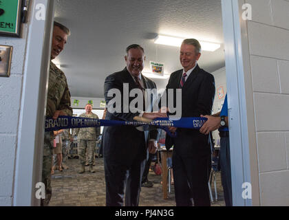 Lt. Gov. Brad Little, lieutenant governor for the state of Idaho, and Michael J. O'Toole, Department of Defense director, civil-military programs, cut a ceremonial ribbon during a grand opening ceremony for Starbase Idaho at Gowen Field, Boise, Idaho on Aug. 31, 2018. The program is a cooperative partnership between local school districts and the Department of Defense allowing students opportunities to explore more education in science, technology, and math. (U.S. Air National Guard photo by Master Sgt. Joshua C. Allmaras) - Stock Image