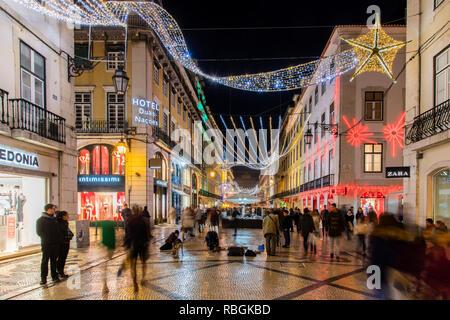 Rua Augusta pedestrian mall adorned with Christmas lights, Lisbon, Portugal - Stock Image