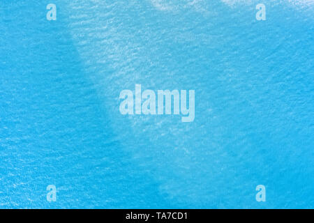 Calm sea surface aerial view. Aqua blue water with ripple texture and background - Stock Image