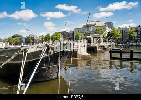 Theater 'Carré' with on the foreground 'Amstelsluizen' in Amsterdam - Stock Image