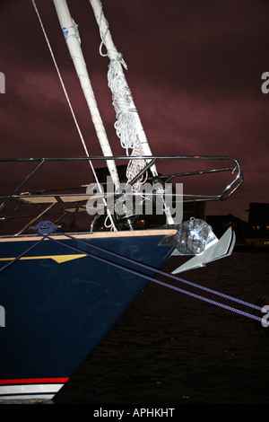 bow of a yacht moored in the dark - Stock Image