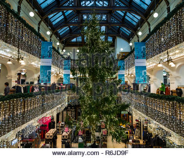 Princes Street, Edinburgh, Scotland, United Kingdom 5th December 2018. Jenners Christmas Tree is an Edinburgh institution. The 40 foot Christmas tree fills the centre of the grand Victorian balconied shopping area - Stock Image