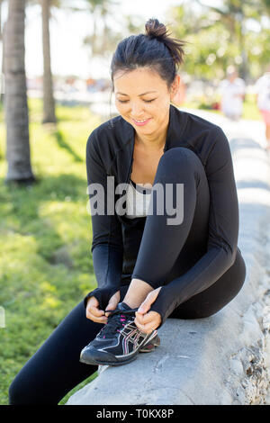 Fit woman walking and exercising. - Stock Image