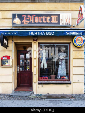 Pforte lll traditional old bar. Exterior view with models in period dress in window. Moabit-Berlin - Stock Image