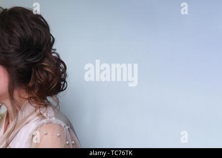 Long hair in hairstyle, ombre, styling in beauty salon. Side view. Wedding and prom ball hairstyles. Beauty industry - Stock Image