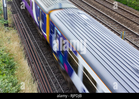 Northern Rail class 156 Sprinter diesel multiple unit train passing at speed with motion blur. - Stock Image