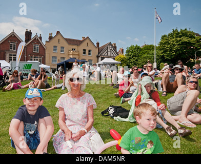 Crowds enjoy entertainment from local performers in glorious sunshine during The Lichfield Festival on Saturday - Stock Image
