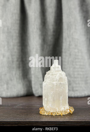 Naturally carved mineral stone Selenite tower has healing on cleansing properties. Also used for recharging other mineral crystal stones. - Stock Image