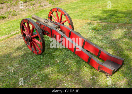 Red cannon at Swedes invasion reenactment picnic in Janowiec Castle, small gun at Swedish assault improvisation - Stock Image