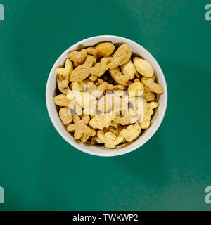 Bowl of Rice Crispies Multigrain Shapes Breakfast Cereals Shot From Above With No People - Stock Image