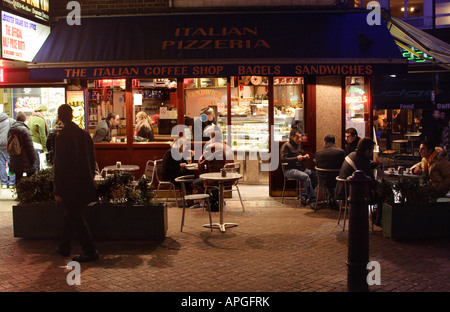 Italian Pizzeria Leicester Square London at night - Stock Image