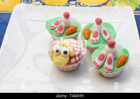 Detail of funny Eastern muffins with rabbit character hiding in the ground and sheep. - Stock Image