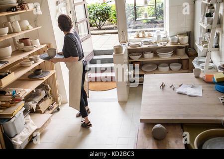 Potter working in studio - Stock Image