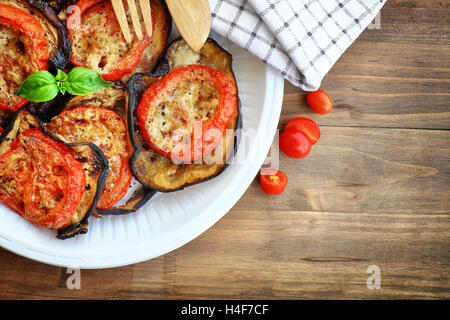 Tasty vegetarian pizza topping, delicious baked eggplant with tomato and cheese, traditional italian food, organic - Stock Image