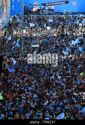 The Manchester City players and staff on stage during the trophy parade in Manchester. - Stock Image
