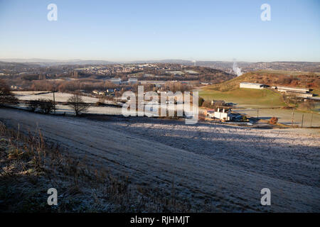 A cold and frosty morning scene in rural Kirkheaton near Huddersfield with the Pennines in the distance - Stock Image