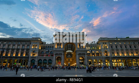 Horizontal streetview of the Galleria Vittorio Emanuele II shopping centre at sunset in Milan, Italy. - Stock Image