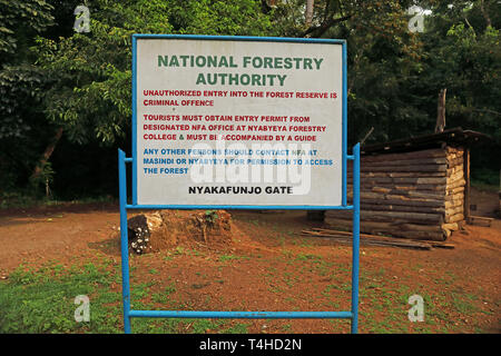 sign giving entry restrictions at park entrance  Kibale Forest National Park, Uganda.       November - Stock Image