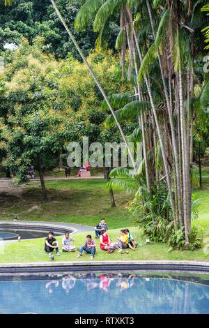 Malaysians Relaxing at KLCC Park, Kuala Lumpur, Malaysia. - Stock Image