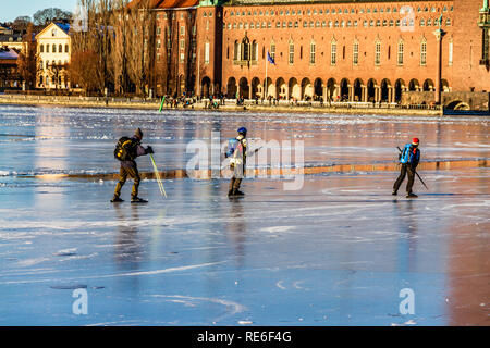 People ice skating on frozen Riddarfjarden, Lake Malaren, in front of the City Hall. Stockholm, Sweden. 20th January, 2019. - Stock Image