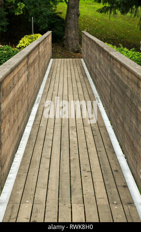 wooden footbridge in a park - Stock Image
