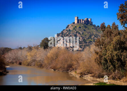 A view along the Guadalquivir River to Castillo de Almodóvar del Río in the Province of Córdoba, Spain. Game of Thrones location. - Stock Image