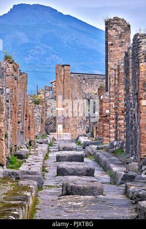 View Of Vesuvius From Ruined Street Pompeii Italy - Stock Image