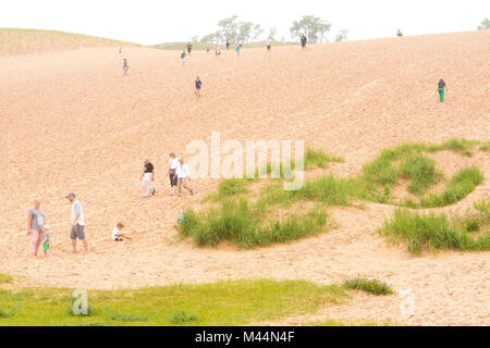 People explore a large sandhill in the Sleeping Bear Dunes national park in Leelanau and Benzie counties, Michigan, - Stock Image
