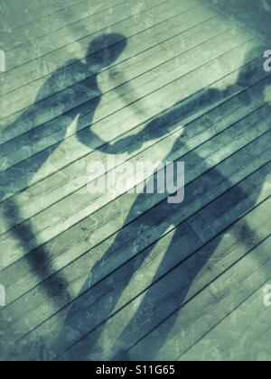 Shadow of a farher and son - Stock Image