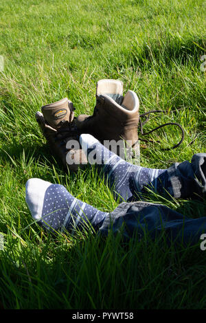 These feet were made for walking....but they still need a break - Stock Image