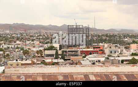 Elevated view of downtown Chihuahua City, Chihuahua, Mexico with tall building under construction. - Stock Image