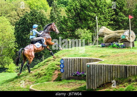 Rockingham Castle, Corby, UK. 21st May, 2017. Izzy Taylor and her horse Zippi Jazzman run uphill towards a log obstacle - Stock Image