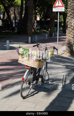 Bicycle decorated with flowers in Sestri Levante, Liguria, Italy - Stock Image