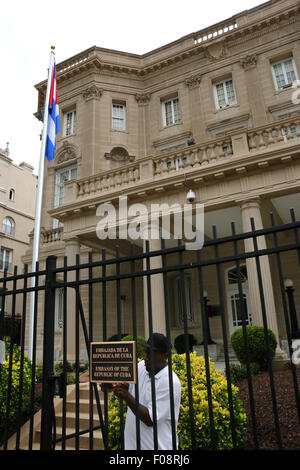 Worker installing sign at the New Cuban embassy Washington D C - Stock Image