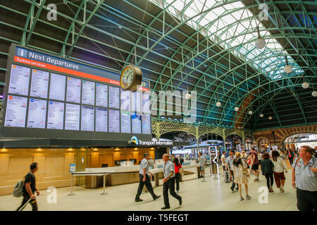 Interior of Central railway station in Sydney, with transport information board and customer help services,Sydney,Australia - Stock Image
