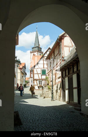 Street scene through an Arch - Stock Image