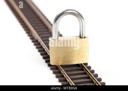 Closed padlock on a single rail isolated on white. - Stock Image