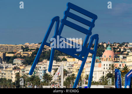 Huge blue chair sculpture by artist SAB alias Sabine Géraudie at Promenade des Anglais in Nice, Cote d Azur, French Rieviera, France, - Stock Image